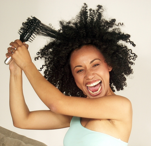 Afro-american-woman-detangling-hair-2 - Opinionated Male Blog