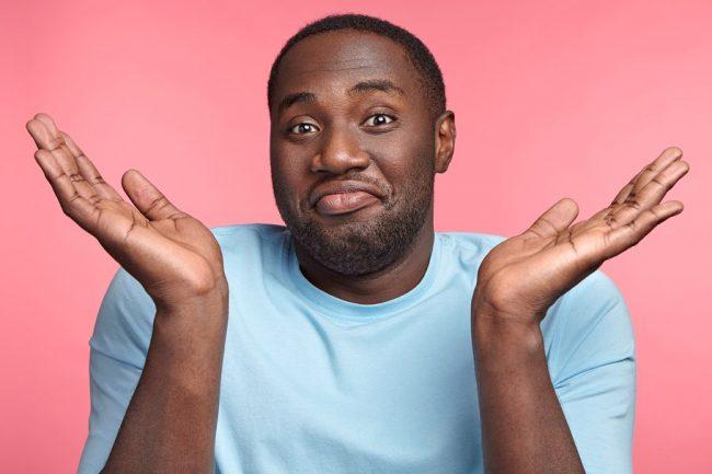 african American man shrugging uncertain - OpinionatedMaleblog-