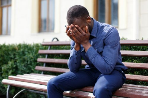 tired-african-american-man-sits-on-the-bench-outside - opinionatedmaleblog