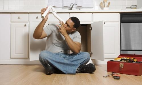 African American Man Fixing - Opinionatedmaleblog-