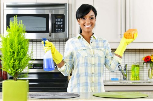 African american Woman in kitchen cleaning - Opinionated Male Blog
