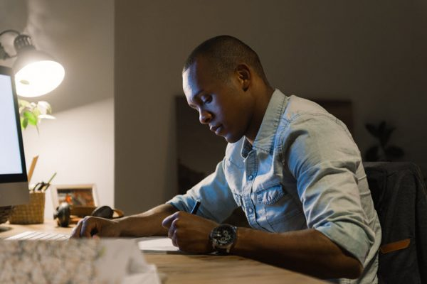 African American Man writing - Relationship Advice - Opinionatedmale blog