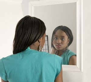 black-girl-looking-in-the-mirror - OpinionatedMale.com