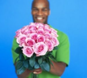 African American Man with Flowers - Nice Guys Finish Last - Opinionated Male